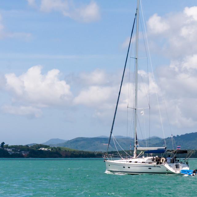 """Yacht sailing under power in Phang Nga Bay"" stock image"