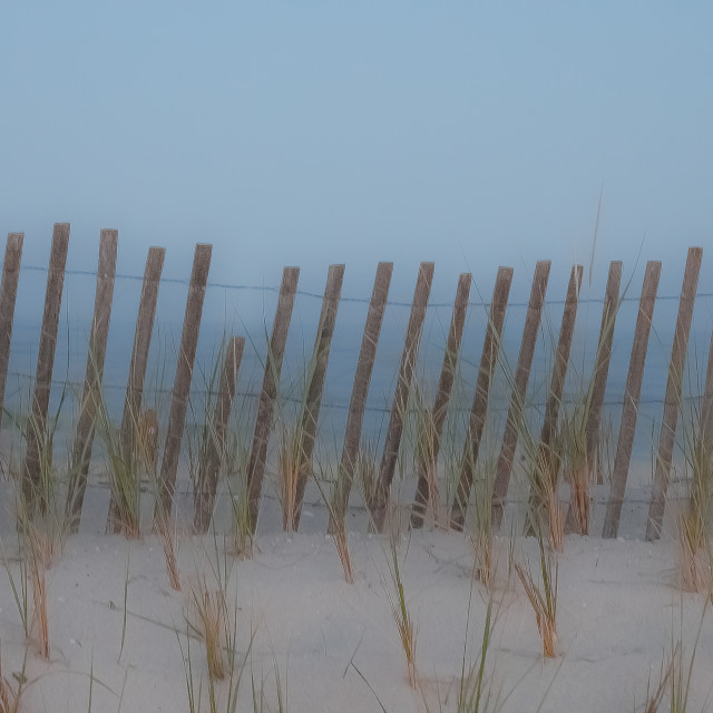 """Beach Fence on the sand dunes"" stock image"