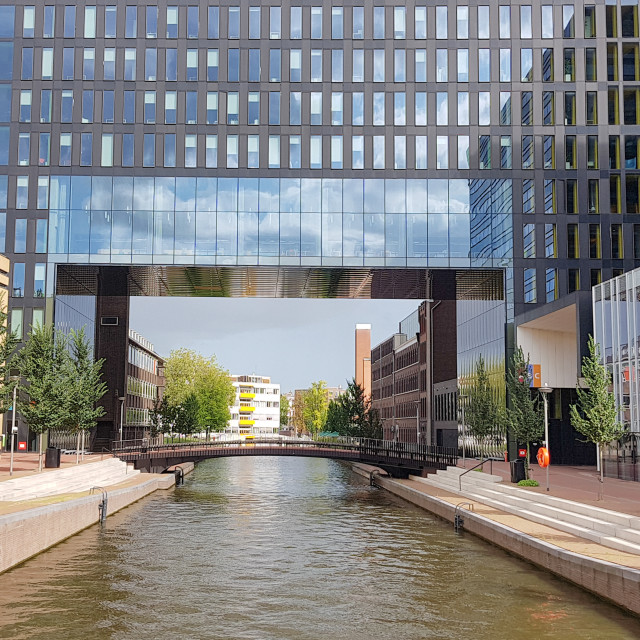"""An office building over canal in Amsterdam"" stock image"