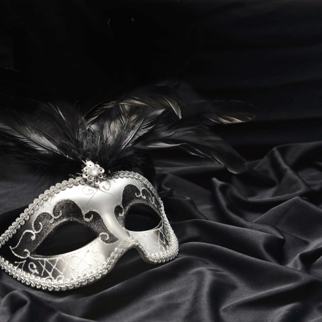 """""""carnival mak with feather on satin fabric background"""" stock image"""