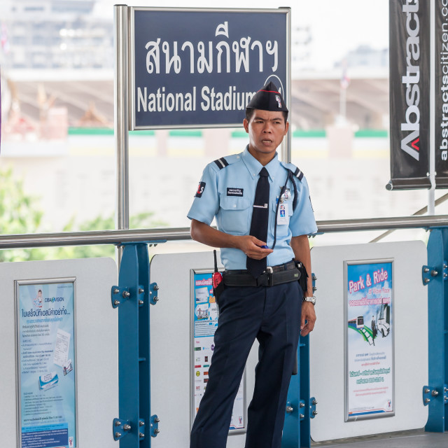 """""""A guard stands on the platform at the National Stadium"""" stock image"""