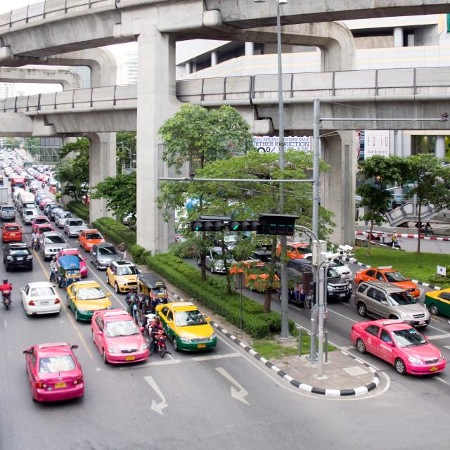 """Busy Bangkok traffic on Phaya Thai road with the Skytrain track overhead,..."" stock image"