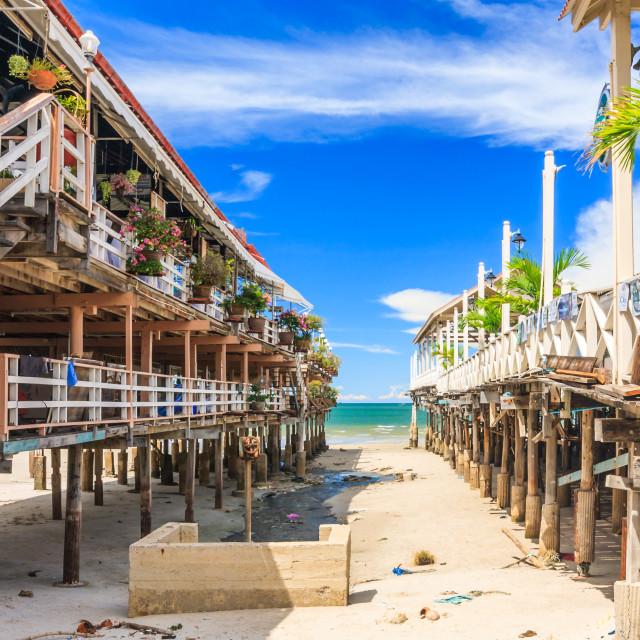 """View bewteen 2 restaurants on stilts to the beach."" stock image"
