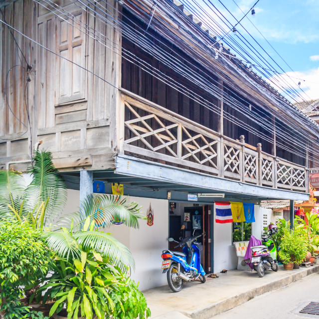 """""""Typical wooden, teak houses in a street."""" stock image"""
