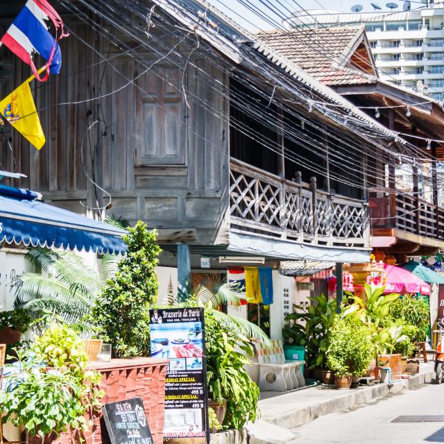 """""""Restaurants in typical teak wooden buildings."""" stock image"""