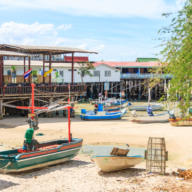 """""""Boats and restaurant piers on the beach at Hua Hin"""" stock image"""