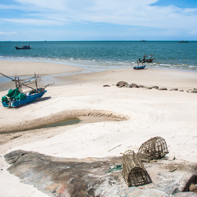 """""""Boats and fish traps on the beach"""" stock image"""
