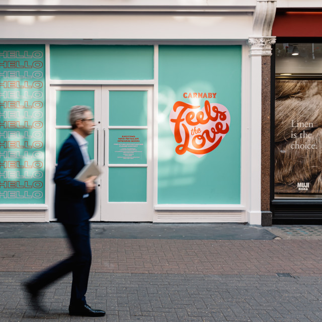 """People moving in front of retail space for rent in Carnaby Street, Soho, London"" stock image"
