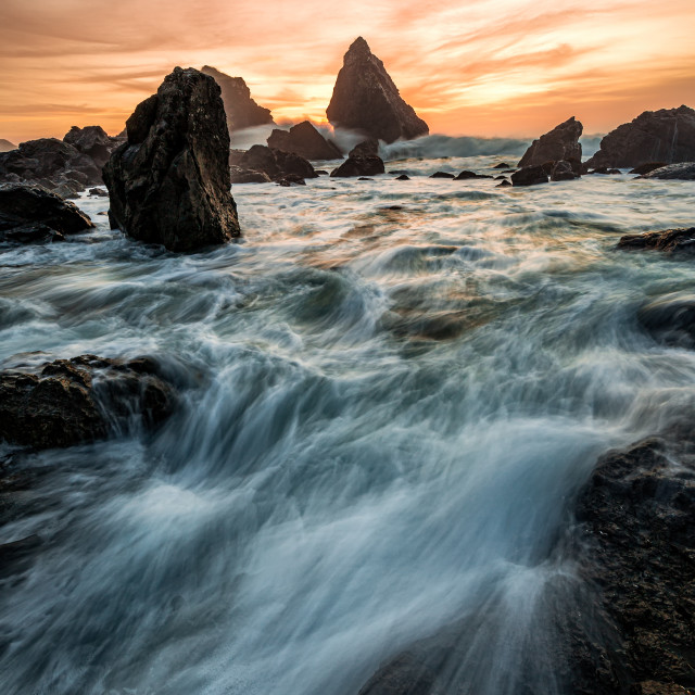 """""""Evening Sunset at a Tropical Rocky Beach"""" stock image"""