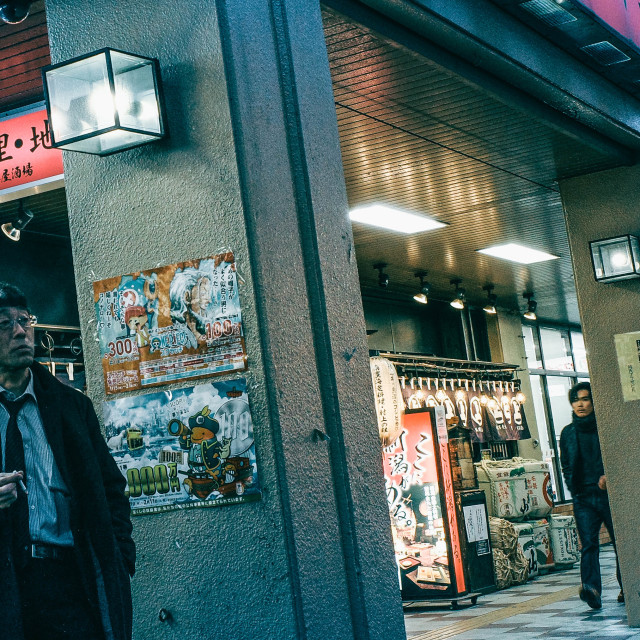 """Niigata - man smoking"" stock image"