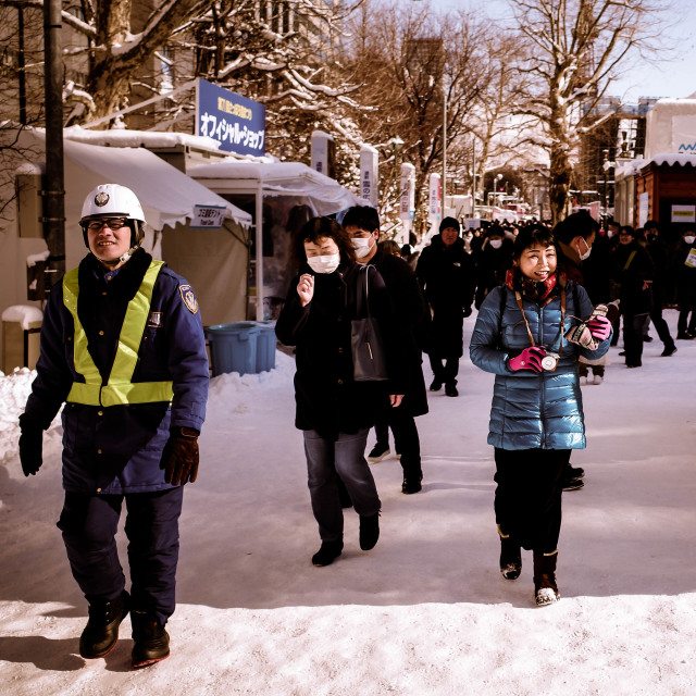 """Police in the sapporo snow"" stock image"