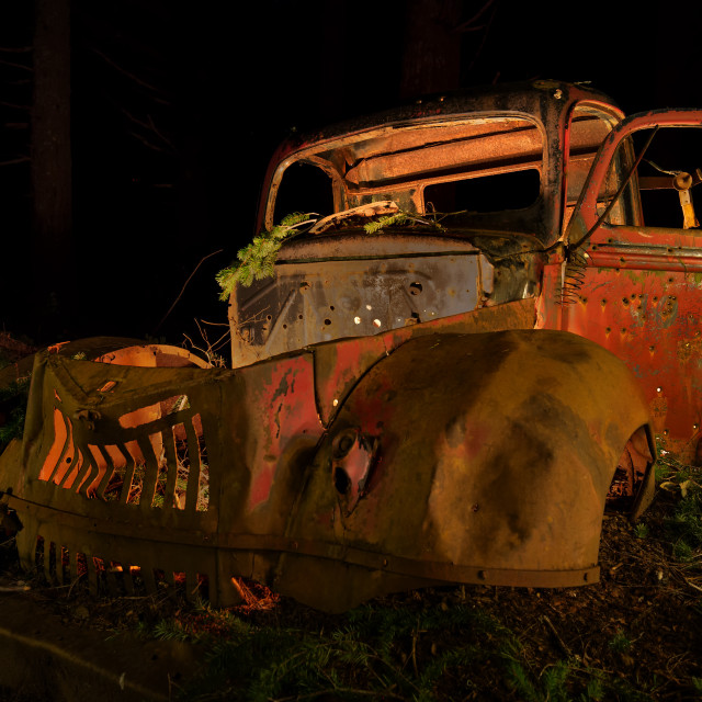 """""""Abandoned Antique Truck Rusting in the Forest at Night"""" stock image"""