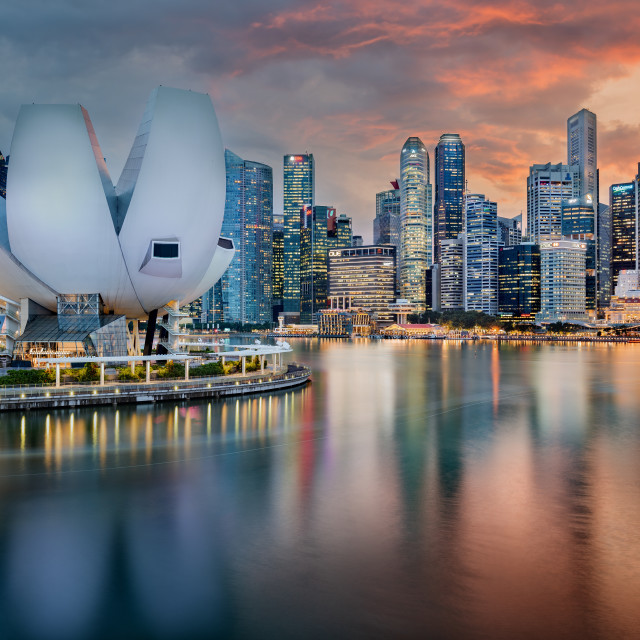 """""""Singapore skyline at Marina bay taken at sunset, with science museum and skyscraper lights reflected in Singapore river"""" stock image"""
