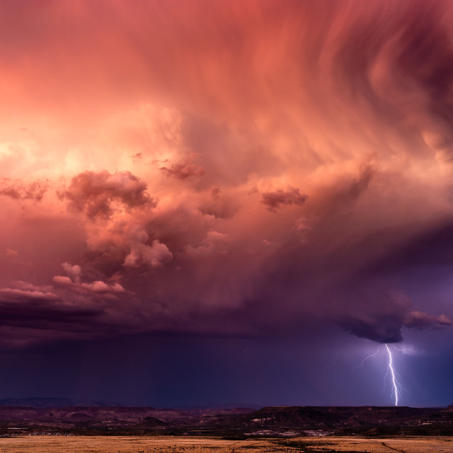 """Stormy sky with dramatic clouds and lightning"" stock image"