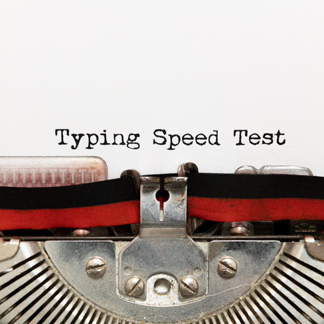 """Typing speed test title text printed on paper with typewriter"" stock image"