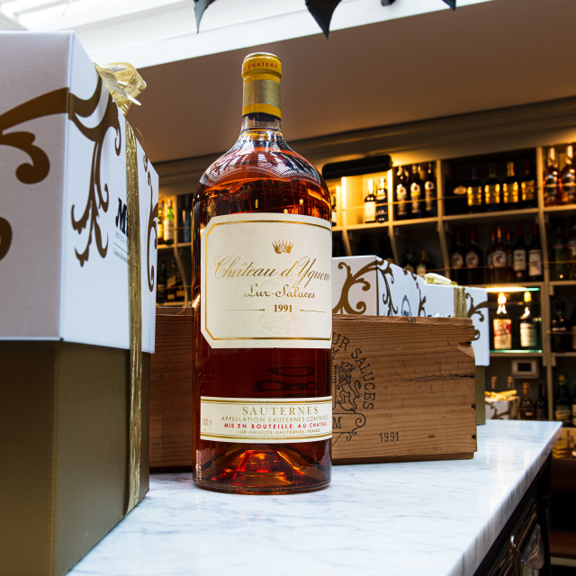 """Luxury french wine Chateau d'Yquem bottle in shop"" stock image"