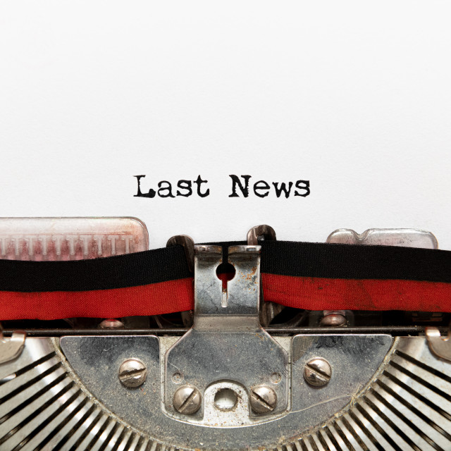 """Last news title text written on paper with typewriter"" stock image"