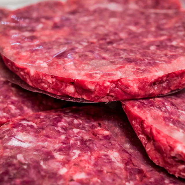"""Hamburger raw meat preparation close up"" stock image"