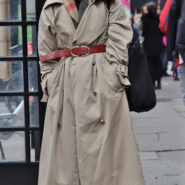 """""""Long coat, small trainers."""" stock image"""