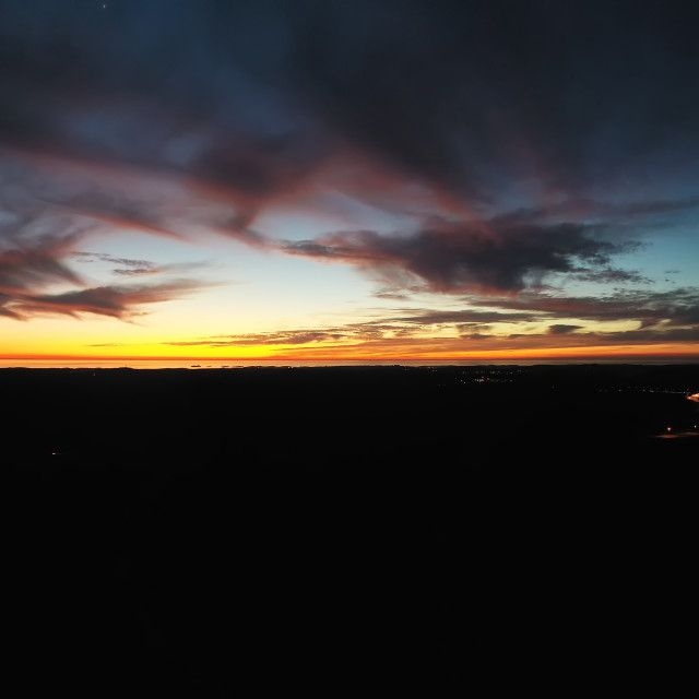 """""""An aerial shot of a sunset"""" stock image"""