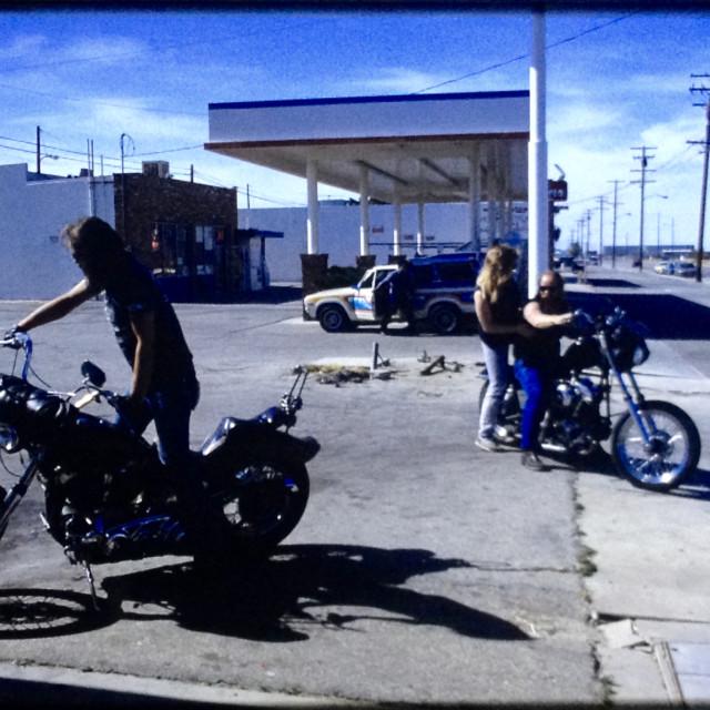 """""""bikers get gas"""" stock image"""