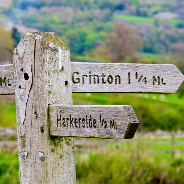 """Signpost to Reeth, Grinton, Harkerside"" stock image"