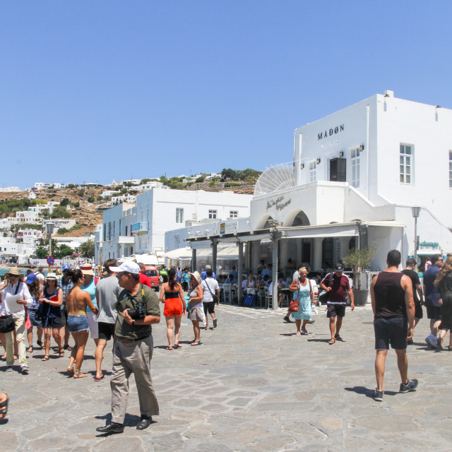 """Mykonos, Greece - July 23rd 2016: Tourists walking around the main square in..."" stock image"