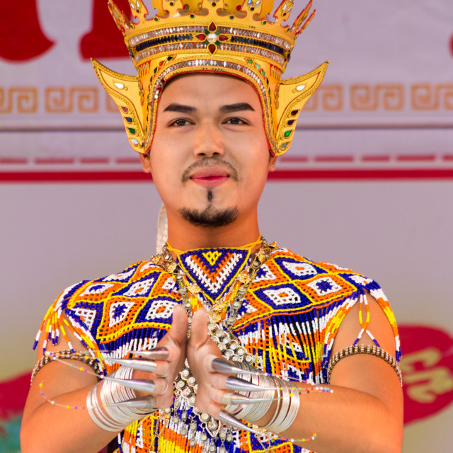 """Male dancer in traditional Thai costume in Phuket Town, Thailand"" stock image"
