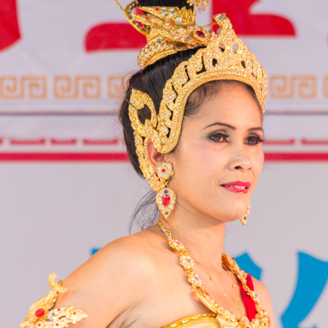 """Female dancer in traditional Thai costume in Phuket Town, Thailand"" stock image"