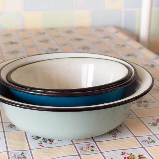 """Old enamel dishes on a table"" stock image"