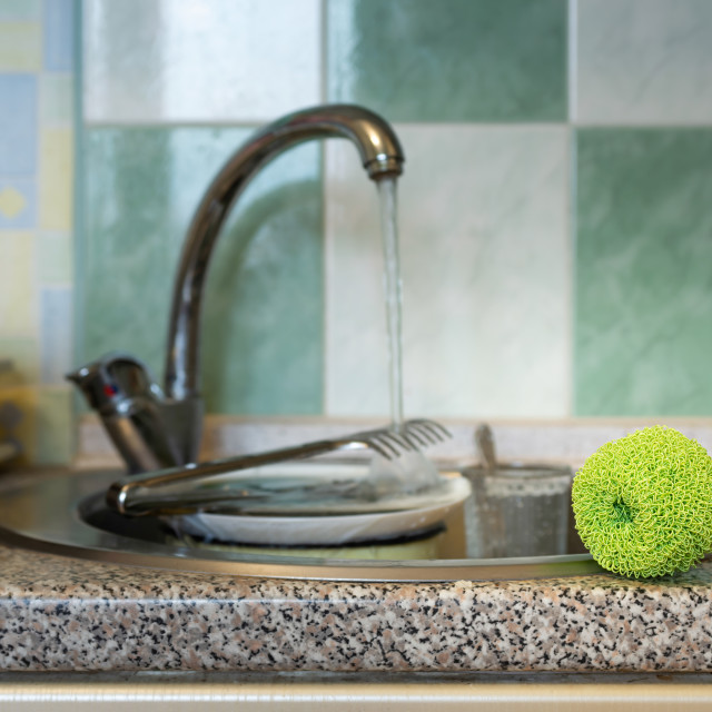 """Plastic mesh scourer close to the sink"" stock image"
