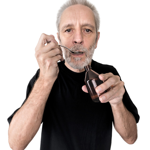 """Man Drinking Cough Syrup"" stock image"