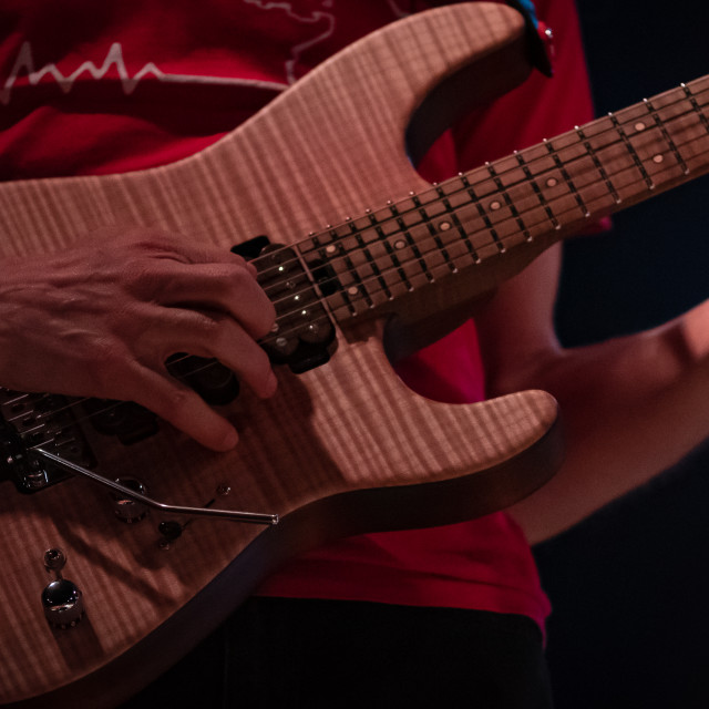 """""""detail of hand playing an electric guitar"""" stock image"""