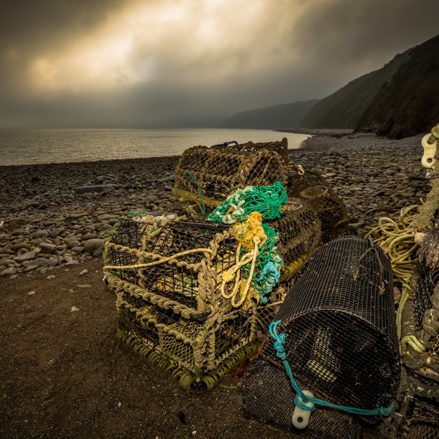 """Lobster pots on the beach"" stock image"