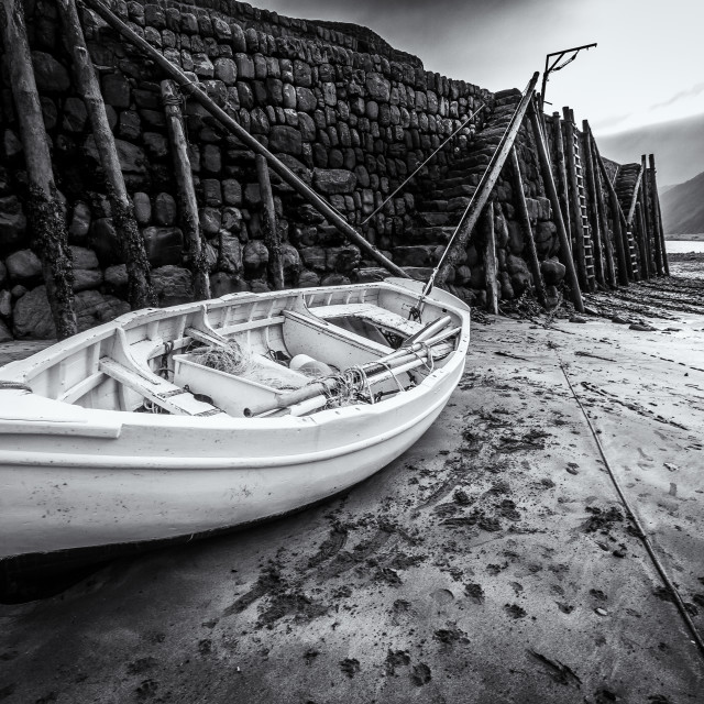 """Beached boat, Clovelly Harbour, North Devon"" stock image"