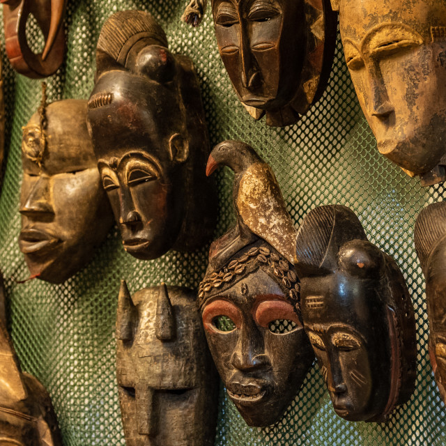 """""""Ornamental African masks on sale in a market"""" stock image"""