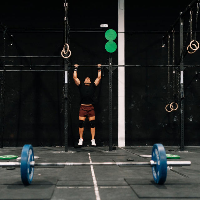"""""""Young muscular man training on bar in a gym"""" stock image"""
