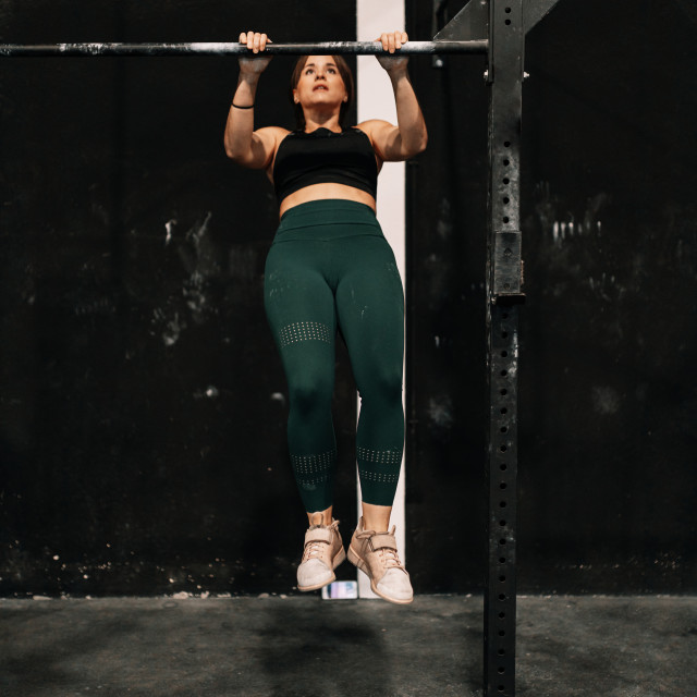 """""""Young woman training on bar in a gym"""" stock image"""