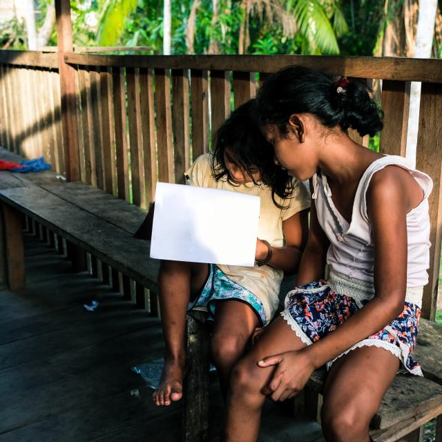 """""""Two amazon girl studying"""" stock image"""
