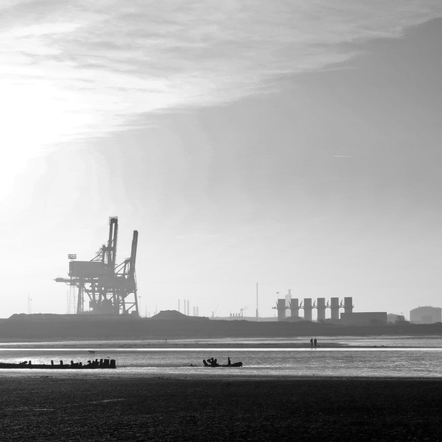 """A walk on the beach in the shadow of industrial Teesside."" stock image"