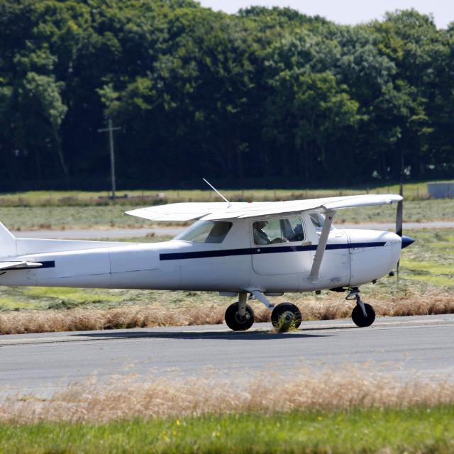 """Light aircraft on runway"" stock image"