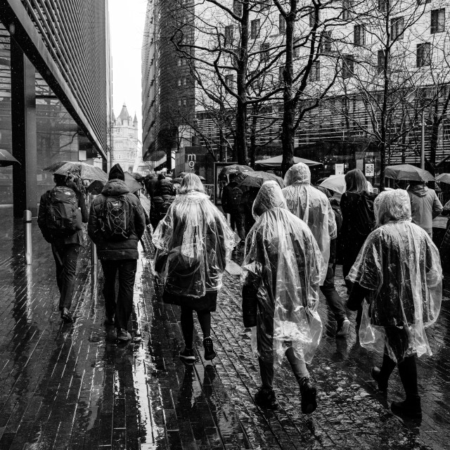 """People in plastic raincoats, More London"" stock image"
