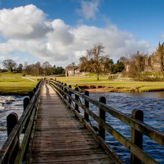 """Footbridge over River Wharfe at Bolton Abbey"" stock image"