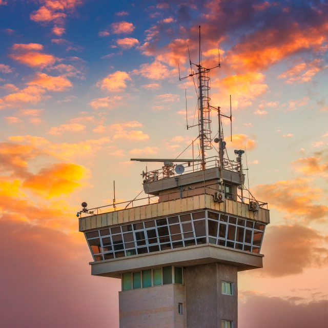 """""""Navigation tower on the sea port against sunrise sky with dramat"""" stock image"""