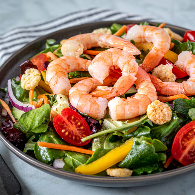 """Fresh shrimp and greens salad on light background"" stock image"