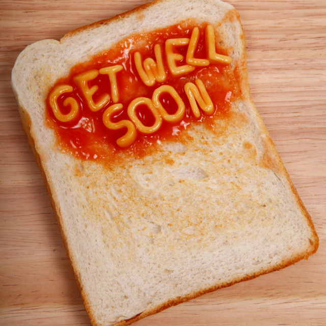 """The words get well soon spelled out on a slice of tast with alphabet spaghetti"" stock image"