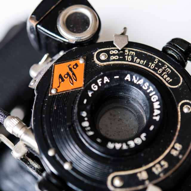 """Vintage retro Agfa Billy photo camera detail on lens and logo"" stock image"