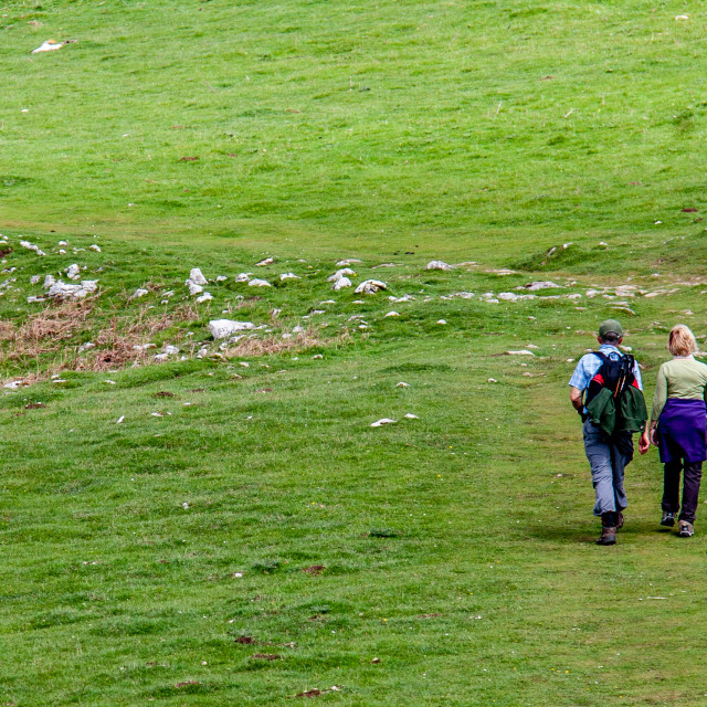 """""""Couple Walklng in the Yorkshire Dales on hilltop path"""" stock image"""