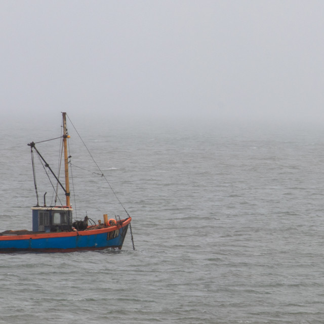 """""""Fishing boat on a misty day"""" stock image"""
