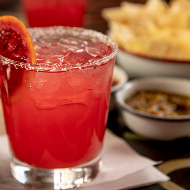 """Blood orange margarita with chips and salsa"" stock image"